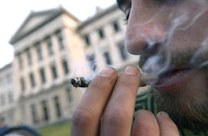 FILE - In this July 31, 2013 file photo, a man smokes…