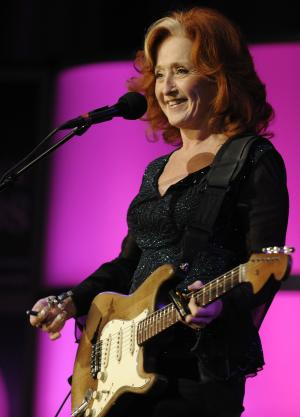"""FILE - In this Oct. 22, 2008 file photo, singer Bonnie Raitt performs at the close of The Women's Conference in Long Beach, Calif. Raitt will be releasing """"Slipstream,"""" her first album in seven years on April 10, 2012. (AP Photo/Chris Pizzello, file)"""