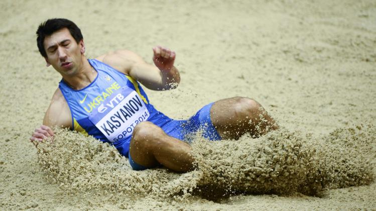 Kasyanov of Ukraine lands during the men's heptathlon long jump event at the world indoor athletics championships at the ERGO Arena in Sopot