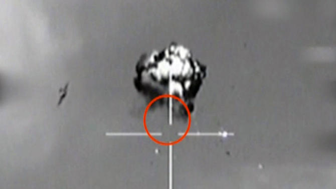 """FILE -  Saturday, Oct. 6, 2012 file image made from video released by the Israeli Defense Forces shows the downing of a drone that entered Israeli airspace in southern Israel. Iran has images of sensitive Israeli military bases taken by a drone that was launched by Lebanon's Hezbollah movement and downed by Israel earlier this month, a senior Iranian lawmaker claimed Monday Oct. 29 2012 in the latest boast from Tehran about purported advances in the capabilities of its unmanned aircraft. The announcement gave no details about the photos — other than calling the Israeli bases """"forbidden sites"""" — but it suggested Iranian drones have the ability to transmit data while in flight. It also appeared aimed at warning Israel about the options for retaliation for any possible strikes on Iranian nuclear sites.  (AP Photo/Israeli Defense Forces via AP video, File)"""