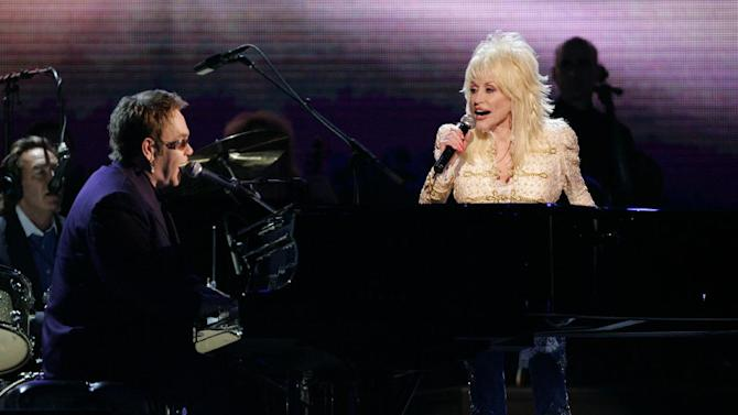 FILE - This Nov. 15, 2005 file photo shows Elton John, left, and Dolly Parton performing at the 39th Annual Country Music Association Awards in New York. The 47th annual awards, hosted by Carrie Underwood and Brad Paisley, airs Wednesday, Nov. 6, 2013. (AP Photo/Julie Jacobson, File)
