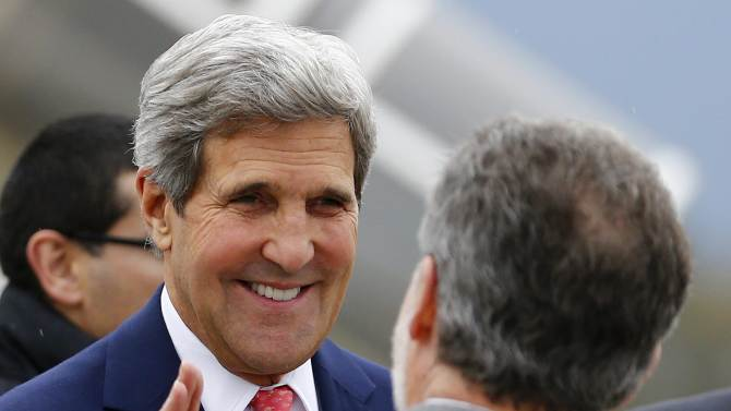 """US Secretary of State John Kerry smiles as he arrives at Geneva International airport, Switzerland Friday Nov. 8, 2013 for closed-door nuclear talks at the United Nations offices. Four world powers are dispatching their top diplomats to Geneva on Friday to add their weight to negotiations aimed at putting initial limits on Iran's ability to make atomic weapons. French, British and German foreign ministers are joining U.S. Secretary of State John Kerry in Geneva, who is coming """"to help narrow differences in negotiations,"""" according to a U.S. official who spoke on condition of anonymity because he was not authorized to release the information. (AP Photo//Denis Balibouse,Pool)"""