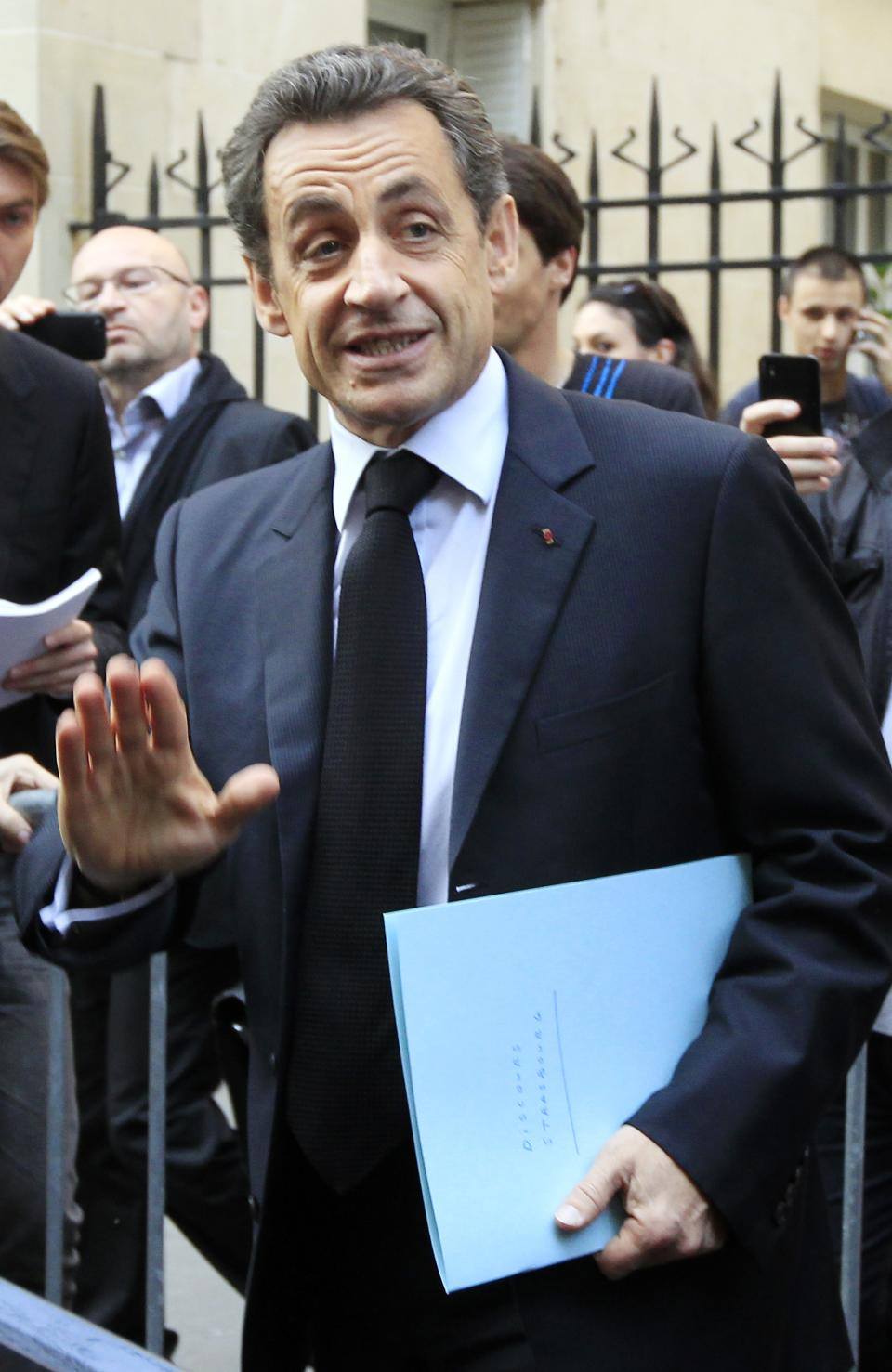 French President Nicolas Sarkozy gestures to supporters near his campaign party headquarters, Paris, Thursday, March 22, 2012. Sarkozy said Thursday an investigation was under way to see if the suspect in a series of radical Islam-inspired killings had any accomplices. (AP Photo/Jacques Brinon)