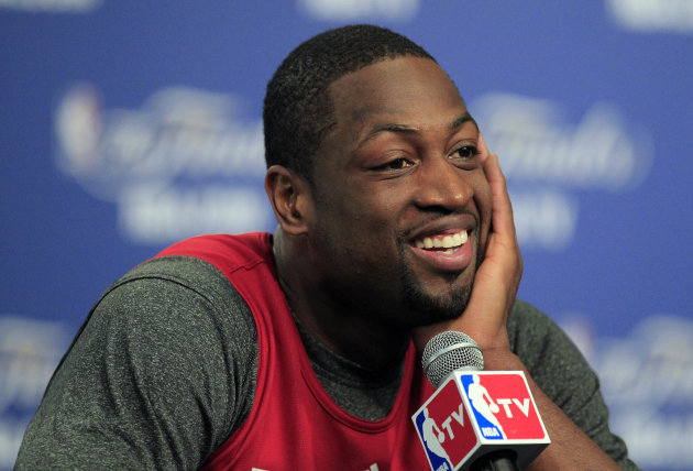 Miami Heat's Dwyane Wade smiles during a news conference Wednesday, June 13, 2012, in Oklahoma City. Game 2 of NBA finals between the Heat and Oklahoma City Thunder is Thursday. (AP Photo/Sue Ogrocki)