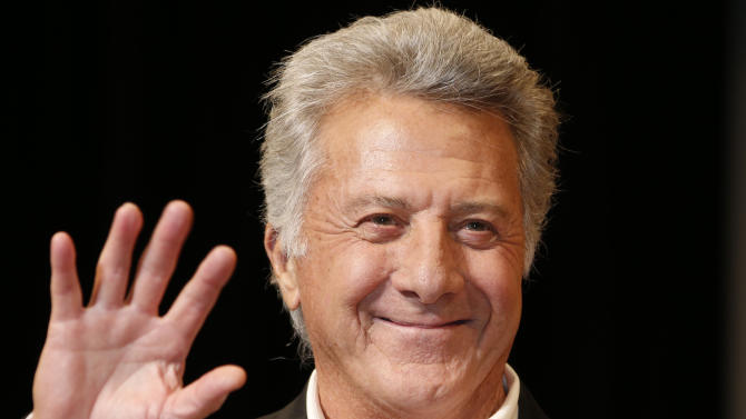 """FILE - In this April 8, 2013 file photo, actor Dustin Hoffman waves to fans during the Japan Premiere of his film, """"Quartet,"""" in Tokyo. A spokeswoman for the 75-year-old actor-director confirmed a People.com report Tuesday, Aug. 6, 2013, that says Hoffman is """"in good health"""" after undergoing surgical treatment for cancer. (AP Photo/Koji Sasahara, File)"""