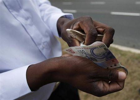 A worker shows his payment outside the Moses Mabhida stadium in Durban