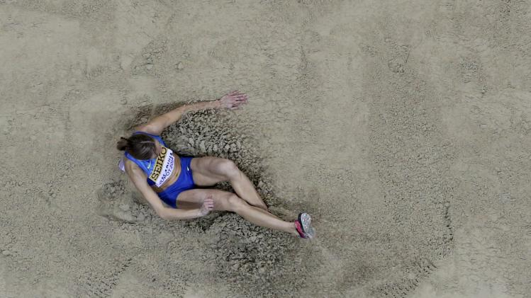Ukraine's Saladukha competes in women's triple jump qualification at world indoor athletics championships in Sopot