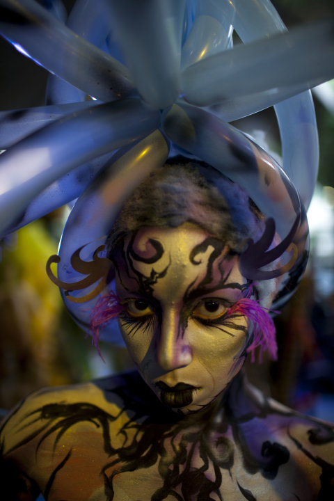 A woman covered in body paint poses at the Teresa Carreno's theater during the VI World Meeting of Body Art in Caracas, Venezuela, Saturday , Nov. 19, 2011. Activities such as body painting, tattooing