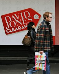 Shoppers are seen walking past advertising signgage outside department store David Jones in central Sydney, on June 29. Australia's corporate watchdog launched an investigation on Tuesday into a short-lived bid for David Jones from a mystery British company that reportedly operates out of a post office box