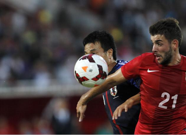 Japan's Yasuyuki Konno, center, challenges for the ball with Serbia's Filip Djordjevic during Serbian Dejan Stankovic's farewell match, at Karadjordje stadium in Novi Sad, Serbia, Friday, Oct. 11, 201