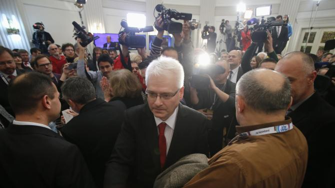 Josipovic shakes hands with a supporter after the first unofficial results in the headquarters in Zagreb