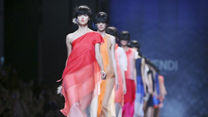 Models wear creations for Fendi women's Spring-Summer 2014 collection, part of the Milan Fashion Week, unveiled in Milan, Italy, Thursday, Sept. 19, 2013. (AP Photo/Antonio Calanni)