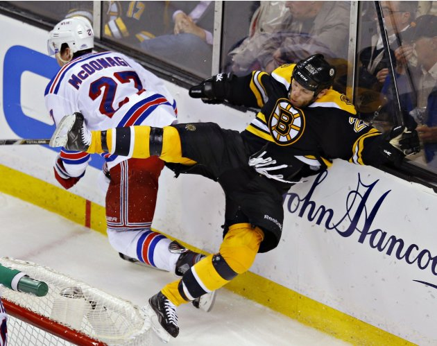Boston Bruins Thornton falls after colliding with New York Rangers McDonagh during Game 5 of their NHL Eastern Conference semi final hockey playoff game in Boston