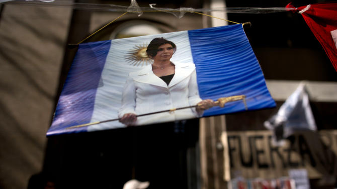 "A picture of Argentina's President Cristina Fernandez hangs outside the Favaloro Hospital where she is undergoing surgery on her skull months after she suffered an unexplained head injury in Buenos Aires, Argentina, Tuesday, Oct. 8, 2013. Fernandez was diagnosed with ""chronic subdural hematoma,"" or fluid trapped between the skull and brain. Doctors initially prescribed a month's rest, but decided surgery was required after she complained of numbness and weakness in her upper left arm Sunday. (AP Photo/Natacha Pisarenko)"