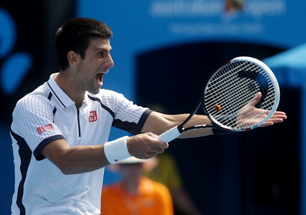 Serbia's Novak Djokovic reacts during his third round round match against Radek Stepanek of the Czech Republic at the Australian Open tennis championship in Melbourne, Australia, Friday, Jan. 18, 2013. (AP Photo/Dita Alangkara)