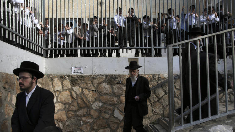Ultra-Orthodox Jews arrive to vote in legislative elections, at a school in Bnie Brak, Israel, Tuesday, Jan. 22, 2013.  Israelis began trickling into polling stations Tuesday morning to cast their votes in a parliamentary election expected to return Prime Minister Benjamin Netanyahu to office despite years of stalled peacemaking with the Palestinians and mounting economic troubles.(AP Photo/Oded Balilty)