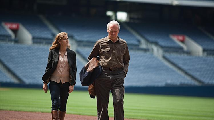 "This film image released by Warner Bros. Pictures shows Clint Eastwood, right, and Amy Adams in a scene from ""Trouble with the Curve."" The film, about an aging and ailing baseball scout, will be released on Sept. 21. (AP Photo/Warner Bros. Pictures, Keith Bernstein)"