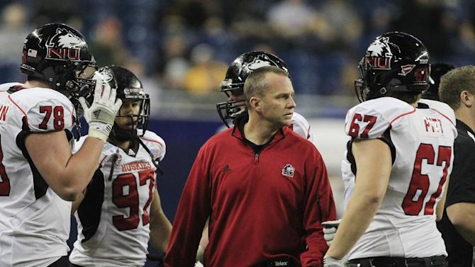 Northern Illinois head coach Dave Doeren, center, prepares to talk to his team during the third quarter of the Mid-American Conference championship NCAA college football game against Kent State, Friday, Nov. 30, 2012. (AP Photo/Carlos Osorio)
