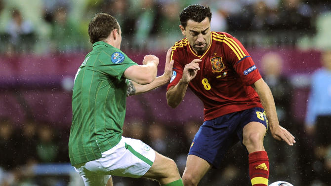 Spain's Xavi Hernandez, right, faces Ireland's Aiden McGeady during the Euro 2012 soccer championship Group C match between Spain and Ireland in Gdansk, Poland, Thursday, June 14, 2012. (AP Photo/Alvaro Barrientos)