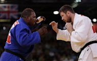 Democratic Republic of Congo's Cedric Mandembo (L) fights with Russia's Alexander Mikhaylin during their men's +100kg elimination round of 32 judo match at the London 2012 Olympic Games August 3, 2012. REUTERS/Toru Hanai