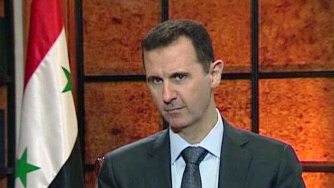 "In this image from video broadcast on Syrian state television Wednesday, April 17, 2013, President Bashar Assad speaks during an interview. Syria's president accused the West on Wednesday of backing al-Qaida in his country's civil war, warning it will pay a price ""in the heart"" of Europe and the United States as the terror network becomes emboldened. The rare TV interview comes as the embattled president's military is fighting to reverse rebel advances, with a rocket attack killing at least 12 people in a central village on Wednesday. (AP Photo/Syrian State TV via AP video"