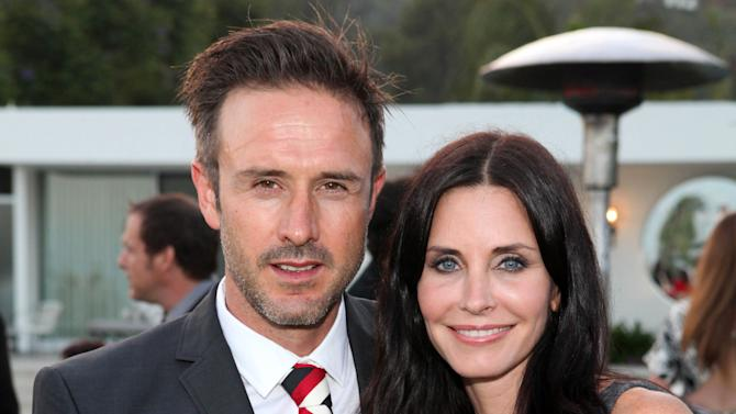 FILE - This June 28, 2011 file photo originally released by InStyle, David Arquette, left, and Courtney Cox attend the Beau Joie Champagne Art Of Elysium Dinner hosted by Rachel Bilson and held at Arquette's home in Beverly Hills, Calif. David Arquette has filed to officially end his 12-year-marriage to actress Courtney Cox Arquette, in the Los Angeles Superior Court, on June 8, 2012. He cited irreconcilable differences in his petition. (AP Photo/InStyle, Casey Rodgers)