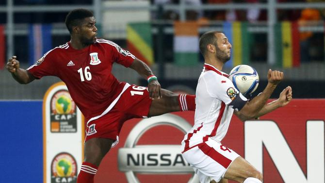 Yassine Chikhaoui of Tunisia fights for the ball with Equatorial Guinea's Armando Sipoto during their quarter-final soccer match of the 2015 African Cup of Nations in Bata