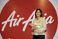 Newly appointed AirAsia CEO of Malaysian Operations Aireen Omar poses at a ceremony in Sepang, outside Kuala Lumpur, on Monday. AirAsia chief Tony Fernandes on Monday said he was handing her his role as head of Malaysia operations to shift focus to oversee the budget carrier&#39;s regional expansion