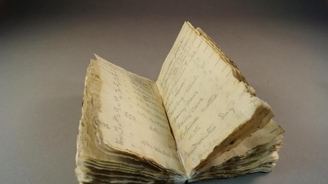 A notebook from Robert Scott's ill-fated Antarctic expedition which was found after a century trapped in the ice of the frozen continent, October 23, 2014