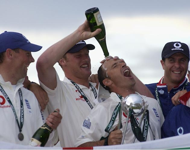 OLD TRAFFORD - JUNE 17:  Nasser Hussain of England celebrates winning with the trophy and Andrew Flintoff during the npower 3rd Test Match at Old Trafford Cricket Ground, Manchester, England on June 1