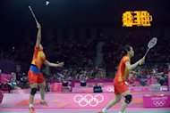"China's Tian Qing (left) plays a shot next to her teammate Zhao Yunlei during their London 2012 Olympic Games women's doubles badminton match against Japan on July 30. Organisers aimed to quell concerns over empty seats by making thousands of tickets available Monday. Some 3,000 tickets were ""put back in the pot"" and sold to the public Sunday, LOCOG said amid growing public anger"
