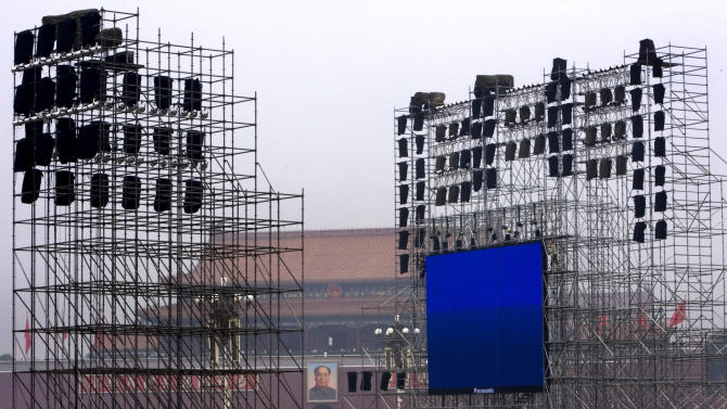 FILE - In this Aug. 5, 2007 file photo, massive scaffolding and an LCD screen are set up on Tiananmen Square ahead of a countdown ceremony to celebrate the coming 2008 Beijing Olympic Games in Beijing. China on Friday, Jan. 4, 2013, joined a global crackdown on price-fixing by manufacturers of LCD screens used in computers and TVs, imposing multimillion-dollar fines on Korea's Samsung and LG and four Taiwanese companies. (AP Photo/Andy Wong, File)