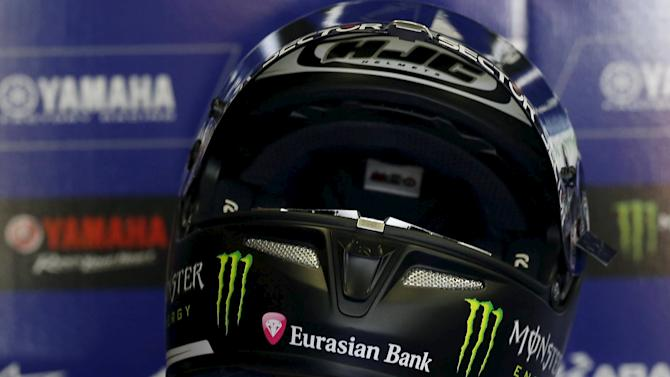 Yamaha MotoGP rider Lorenzo of Spain puts his helmet on during a free practice session at the Twin Ring Motegi circuit ahead of Sunday's Japanese Grand Prix in Motegi, north of Tokyo