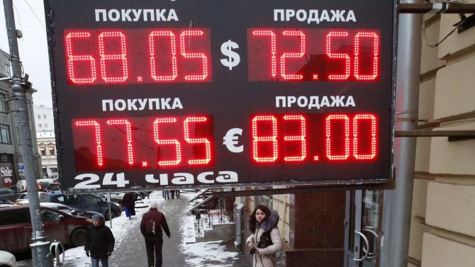 A board showing currency exchange rates is on display in central Moscow