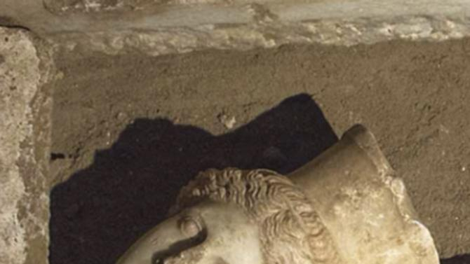 Handout photo shows the head of a sphinx seen inside a site of an archaelogical excavation at the town of Amphipolis