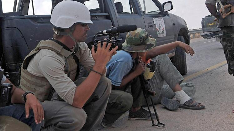 US freelance reporter James Foley (L) is seen at work in Sirte, Libya, on September 29, 2011