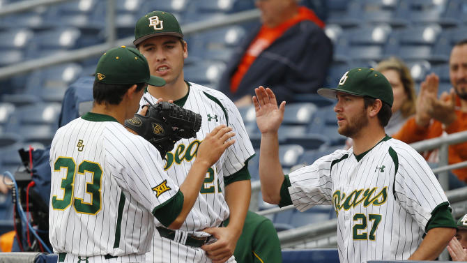 Baylor starting pitcher Theron Kay (33) is greeted by teammates Daniel Castano, center, and Drew Tolson (27) as he returns to the dugout after being taken out of the game in the sixth inning of a semi-final game against Texas during the NCAA college Big 12 conference baseball tournament Saturday, May 23, 2015, in Tulsa, Okla. Texas won 4-0. (AP Photo/Sue Ogrocki)
