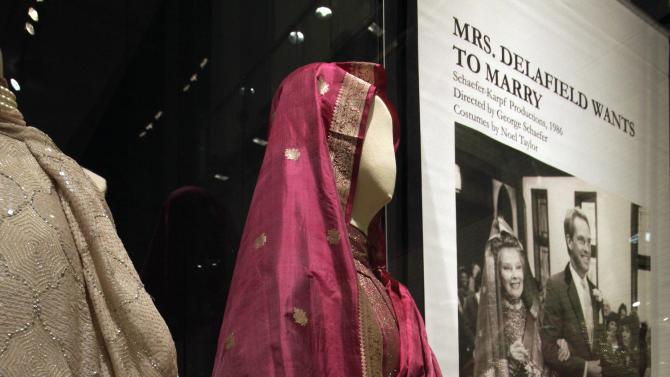 "Designs by Noel Taylor, from the 1986 television movie ""Mrs. Delafield Wants to Marry,"" are shown as part of the ""Katharine Hepburn: Dressed for Stage and Screen"" exhibit in the New York Public Library for the Performing Arts at Lincoln Center,  Tuesday, Oct. 16, 2012. (AP Photo/Richard Drew)"