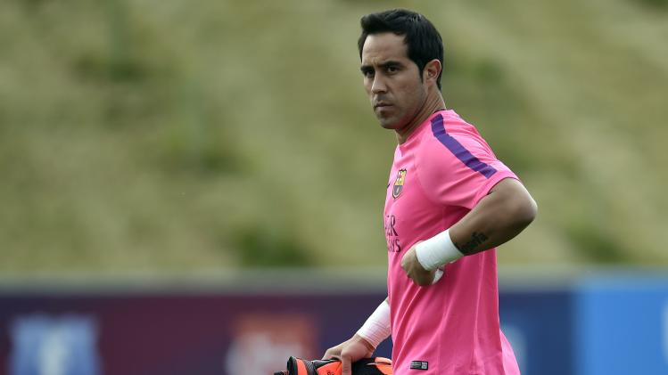 Barcelona's goalkeeper Claudio Bravo arrives for a training session at St. George's Park near Burton on Trent