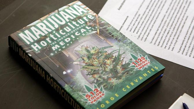 ** HOLD FOR STORY BY KRISTEN WYATT **  In this photo taken on Saturday, Feb. 9, 2013, a textbook on Marijuana Horticulture sits on a desk during the first class at the THC University in Denver. (AP Photo/Ed Andrieski)