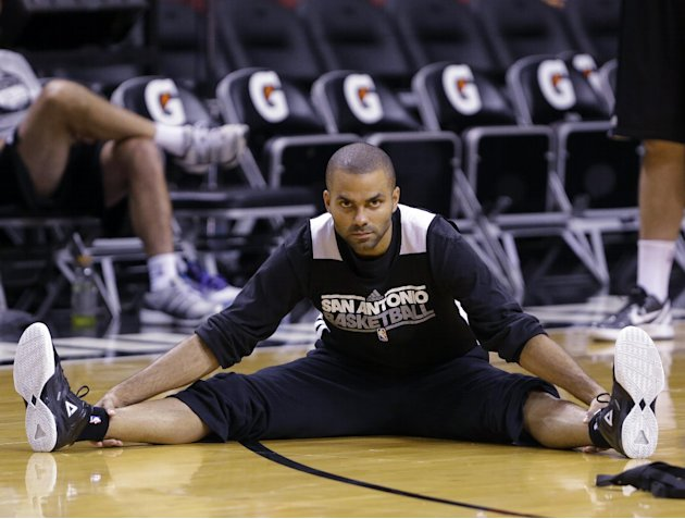 San Antonio Spurs point guard Tony Parker of France, stretches during NBA basketball practice, Wednesday, June 19, 2013, at the American Airlines Arena in Miami. The Spurs take on the Miami Heat in Ga