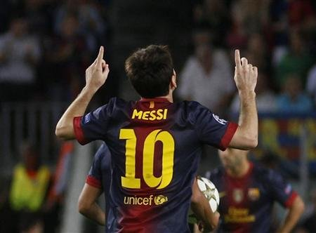 Barcelona's Messi celebrates after scoring a goal against Spartak Moscow during their Champions League Group G soccer match in Barcelona