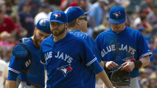 Toronto Blue Jays' starting pitcher Drew Hutchinson walks from the mound after being relieved during the fifth inning of a baseball game against the Cleveland Indians, in Cleveland, Sunday, May 3, 2015. (AP Photo/Phil Long)