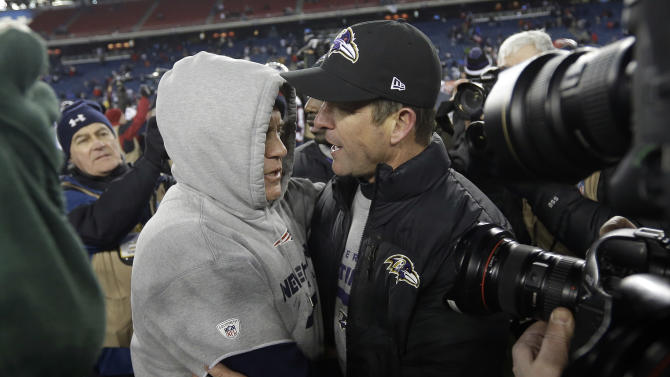 New England Patriots head coach Bill Belichick, left, and Baltimore Ravens head coach John Harbaugh, right, meet at midfield after the NFL football AFC Championship football game in Foxborough, Mass., Sunday, Jan. 20, 2013.  The Ravens won 28-13 to advance to Super Bowl XLVII. (AP Photo/Elise Amendola)