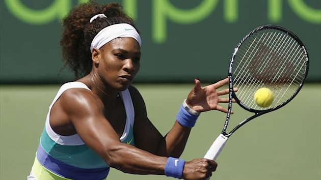 Serena Williams hits a backhand against Italy&#39;s Flavia Pennetta at the Sony Open tennis tournament in Key Biscayne, Florida (Reuters)