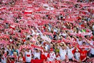 Polish football fans cheers their team in the Warsaw Fanzone. About 110,000 football fans came to the fanzone in the center of Warsaw to watch the first match of the EURO 2012 between Poland and Greece