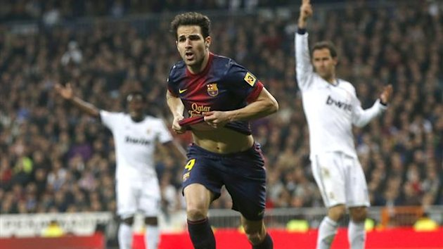 Cesc Fabregas celebrates scoring for Barcelona against Real Madrid (Reuters)