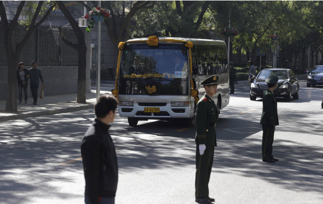 A mini-bus carrying the casket with former Cambodian King Norodom Sihanouk leaves from the Beijing hospital for the airport in Beijing, China, Wednesday, Oct. 17, 2012. Sihanouk died Monday at age 89