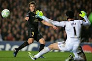 Chelsea's Czech goalkeeper Petr Cech (R) stops a strike from Barcelona's Spanish midfielder Cesc Fabregas (L) during the UEFA Champions League semi-final first leg football match at Stamford Bridge in London. Chelsea won 1-0