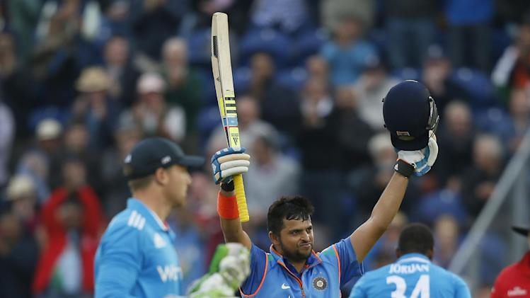 India's Suresh Raina celebrates getting 100 runs not out, during their One Day International cricket match against England at the SWALEC cricket ground in Cardiff, Wales, Wednesday, Aug. 27, 2014. (AP Photo/Alastair Grant)